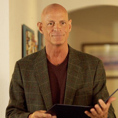Colonel Hank Mills played by John J. Bennett