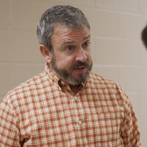 Coach Kelvin played by John Wilson