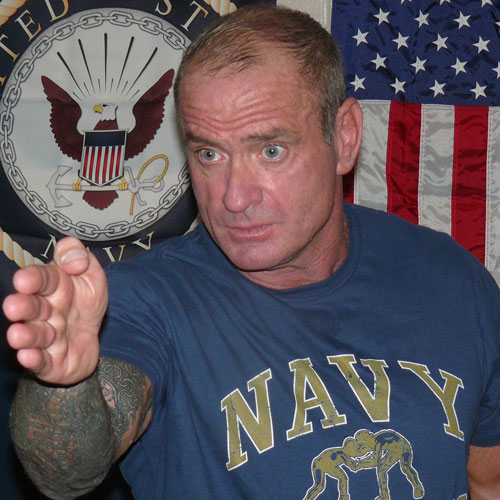 Navy Coach Givens played by Terry Schappert